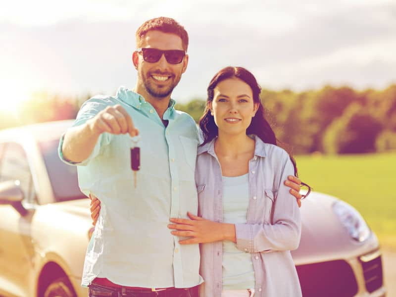 Couple with personal car leasing car